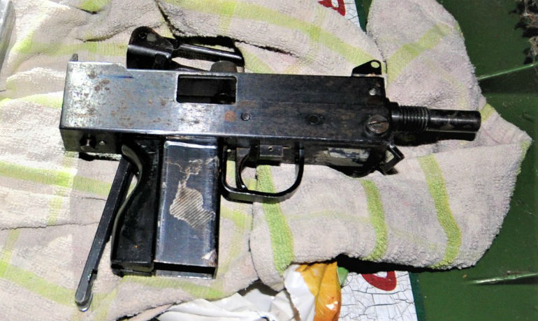 Pair Held After Gun Find