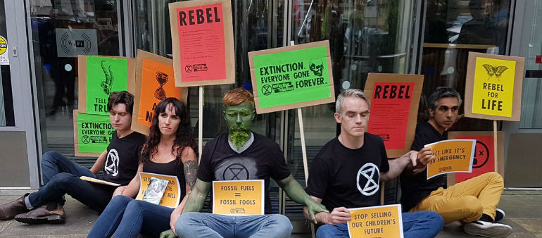 Climate activists have glued themselves to the doors of a government building